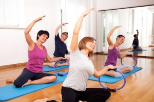 A group of adults participating in a group Pilates class in Dubai